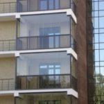 Фото фасада с панорамным остеклением