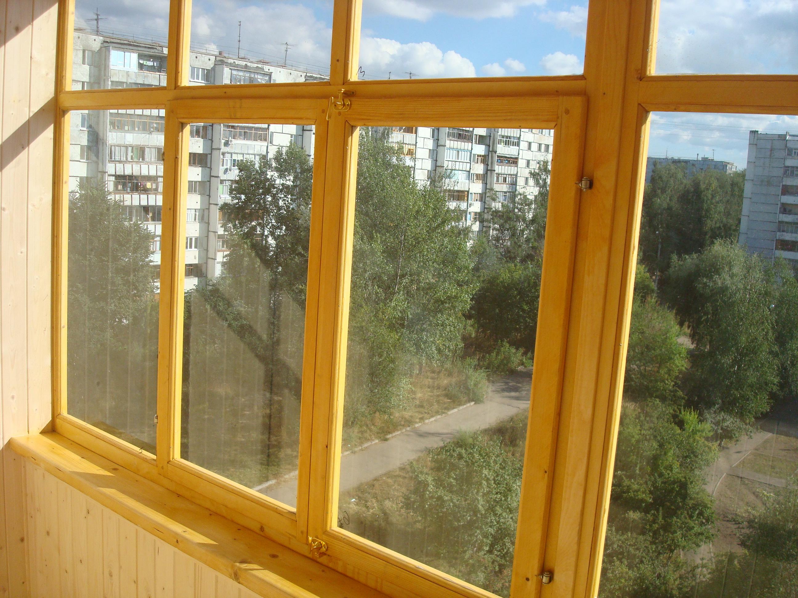 Балкон остекленный деревом вид изнутри