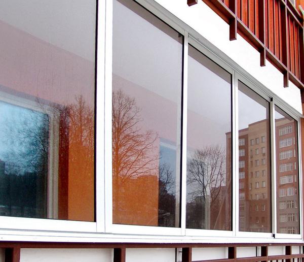 Фото лоджии остекленной раздвижными пластиковыми окнами